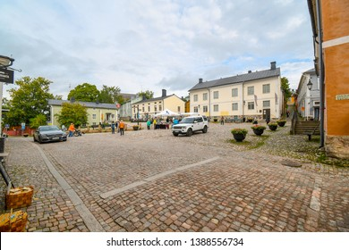 Porvoo, Finland - September 11 2018: Tourists and local Finns begin to set up market stalls in the town square in front of the Porvoo Museum in the medievla village of Porvoo, Finland