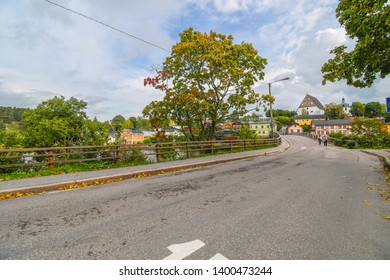 Porvoo, Finland - September 25 2018: The medieval Porvoo cathedral is seen on a hill in the distance as the trees turn to autumn colors in the medieval village of Porvoo, Finland.