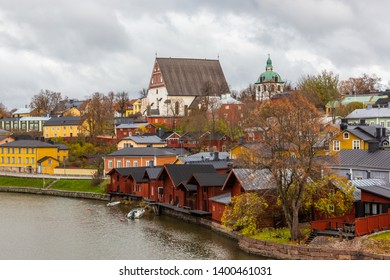 Porvoo town, Finland. Old red wooden houses on the river coast on a cloudy day