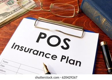 POS Insurance Plan on a table. (Point of Service)