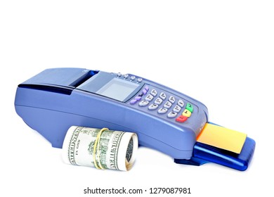 Pos payment terminal with fake empty clear plastic Bank card inserted into the card reader and roll of hundred USA dollar banknotes on white background. Isolated.