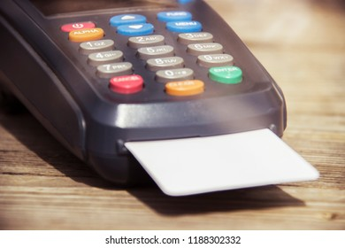 POS payment terminal on wooden background. Credit card terminal, EFTPOS terminal
