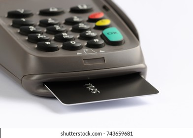 POS terminal with credit card. Close-up view of payment terminal device with chip card inserted
