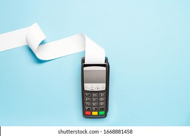 pos terminal with long cash register tape on blue background. shopping theme - Shutterstock ID 1668881458