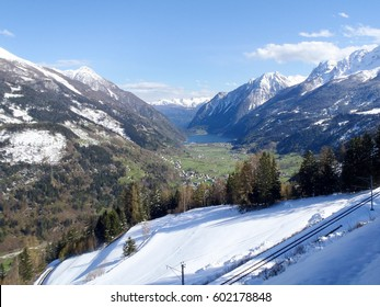 Poschiavo, Switzerlan: Panorama of snow-capped mountains with a beautiful blue sky.
