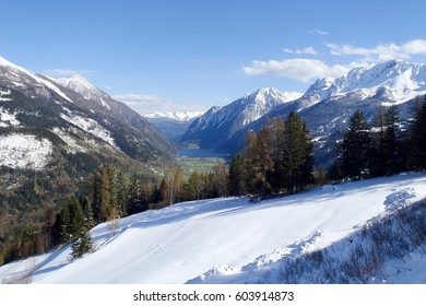 Poschiavo, Switzerland: Panorama of snow-capped mountains with a beautiful blue sky.