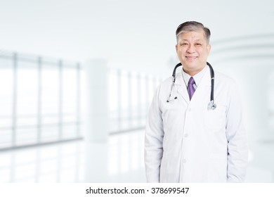 pose and gesture of old Asian man doctor in white uniform