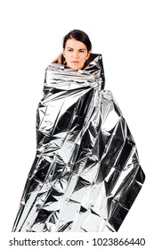 Pose of an upset hiker woman wrapped in an emergency survival blanket- isolated on white.
