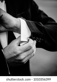 Posed groom with button hole.Wedding details, beautiful boutonniere