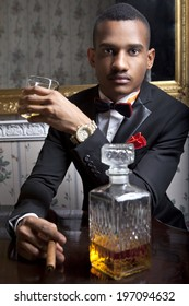 Posh, black man drinks whiskey in the hotel room