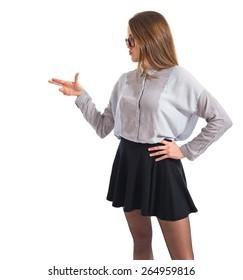 Posh girl making gun gesture