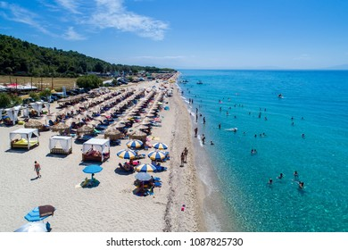 Posidi, Chalkidiki, Greece - July, 26 2017: Aerial view of the beautiful Aigeopelagitika beach in Chalkidiki,Greece. Visit the summer hundreds of tourists daily from the Balkans and from Europe