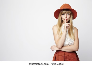 Posing blond woman with a secret, portrait