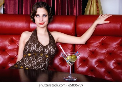 The posing girl at restaurant in style old-fashioned