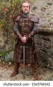 Posing impressive Knight in historic medieval cloth