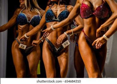 posing women in swimsuit competition fitness bikini