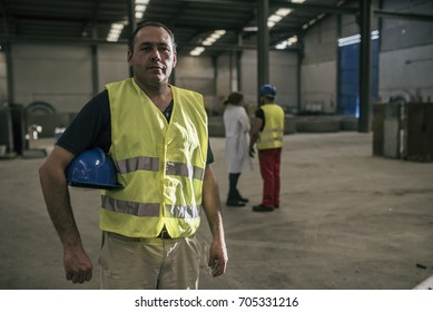 Posing worker in concrete factory looking at the view
