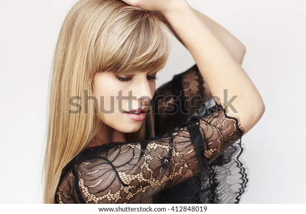 Posing young model in studio, close up