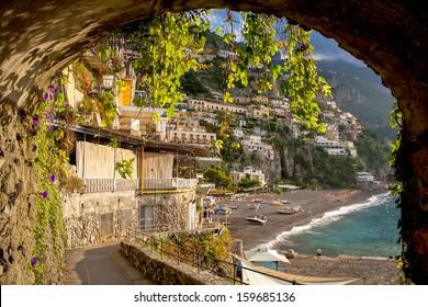 Positano beach through archway