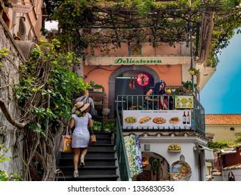 POSITANO, ITALY - APRIL 21, 2018 :  Unknown tourirs in delicates minimarket at  Positano town , Amalfi Coast, Italy.