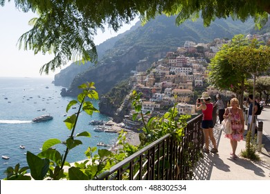 Positano, Italy - July 7, 2016: Tourists in costiera alamfitana in Positano, Italy. Amalfi coast attracts more than 1 million people every year.