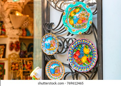 Positano, Italy - September 30, 2017: Traditional colorful ceramics plates made of clay on display in Positano town, Amalfi coast, Italy