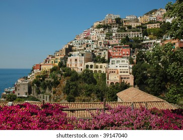 Positano on the Amalfi coast of Italy, with Bougainvilleas in the foreground