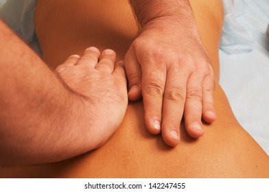 position of hands at lymphatic drainage massage of a female body
