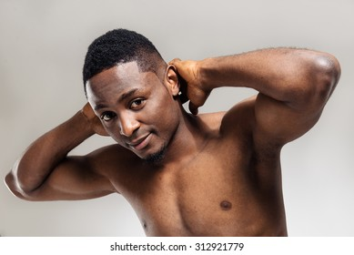 Positive african american muscular man after sports training