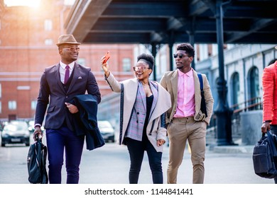 positive african tourists taking selfie while going on the street. trip, holiday. vacation concept