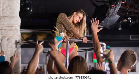 Positive american gogo dancer woman dancing in the night club on holiday