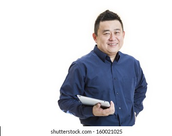 A positive Asian male office worker front view holding tablet on isolated white background.