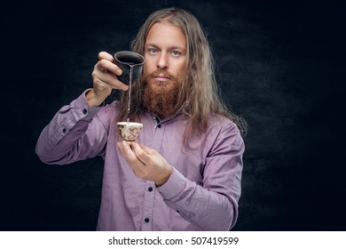 Positive bearded male enjoing Chinese tea.