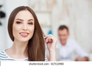 Positive beautiful woman working in the office