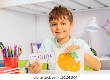 Positive boy in development class with word and object card during ABA therapy