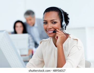 Positive business partners working at computers in the office