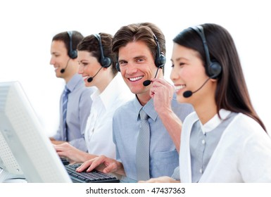 Positive business people talking on headset in a call center