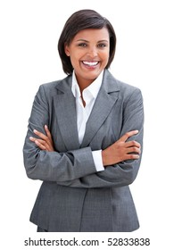 Positive businesswoman with folded arms standing against a white background