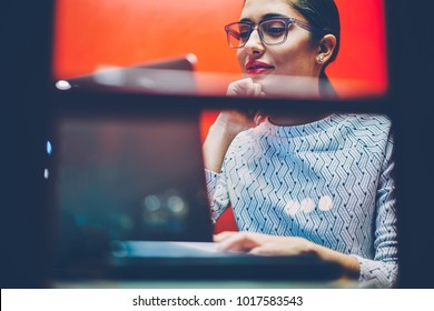 Positive businesswoman preparing for video conference using application on laptop computer sitting in cabin,female manager making online call using wireless internet and netbook in noise insulance box