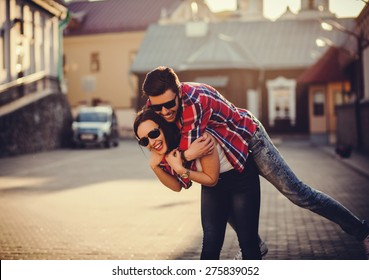 positive and carefree couple having fun in city