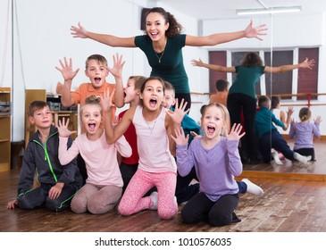 Positive children  in dance studio smiling and having fun
