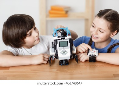 Positive children playing with robot