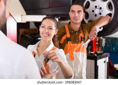 Positive client satisfied with mechanics renewal result indoor