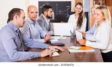 Positive colleagues discussing a price development in the office