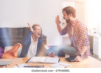 Positive colleagues giving high five