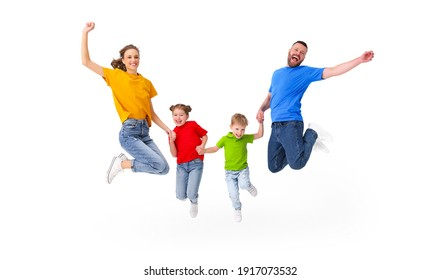 Positive couple and kids jumping with outstretched arms above ground in studio on white background while having fun and celebrating victory