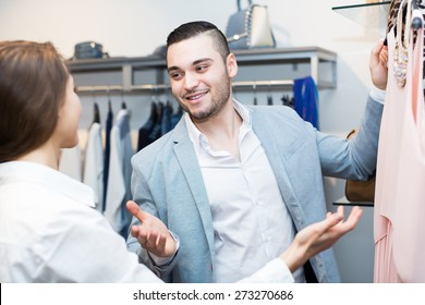 Positive customer consulting with female shop assistant