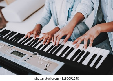 Positive Day with Mother and Daughter. Offspring with Mother Play on Piano. People Play on Piano. Emotion and Good Time with Babysitter. Positive Time. Creativity Young Girl Play on Piano.