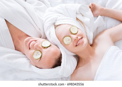 Positive delighted females doing face mask