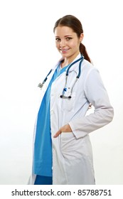 Positive doctor with hands in pockets of her coat isolated on white background